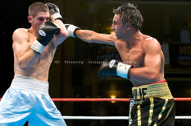 Paulie Malignaggi  (black trunk) on the attack against Jeremy Yelton during their 8 Rounds Jr. Welterweight fight at the Hammerstein Ballroom in New York, NY on 08.25.05.  Malignaggi won by Unanimous decision.