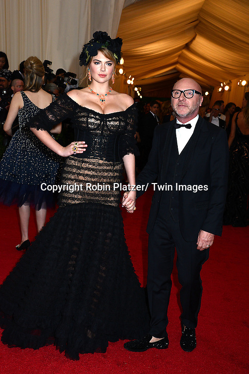 Kate Upton and Dominco Dolce attends the Costume Institute Benefit on May 5, 2014 at the Metropolitan Museum of Art in New York City, NY, USA. The gala celebrated the opening of Charles James: Beyond Fashion and the new Anna Wintour Costume Center.