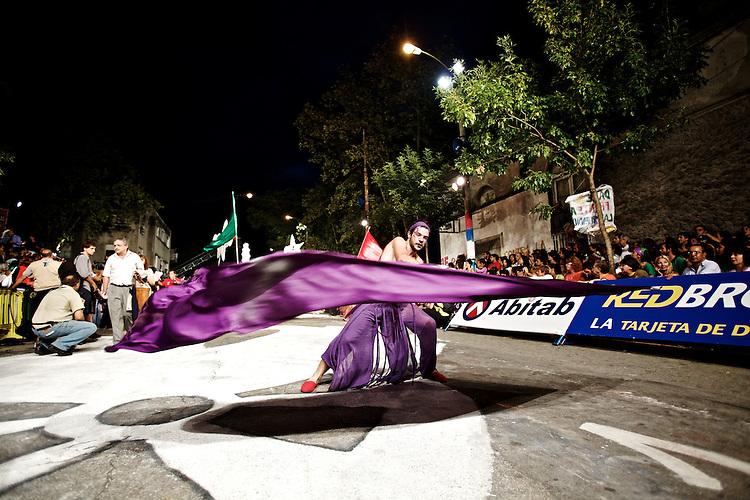 Banderillero de La Melaza showing the purple flag from the group.  La Melaza.  The Llamadas parade 2009.