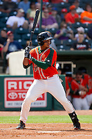 Jesus Solorzano (12) of the Greensboro Grasshoppers at bat against the Delmarva Shorebirds at NewBridge Bank Park on May 26, 2013 in Greensboro, North Carolina.  The Grasshoppers defeated the Shorebirds 11-2.  (Brian Westerholt/Four Seam Images)