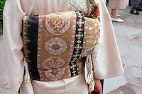 At a wedding in Tokyo the bride wears a traditional white kimono, known as the shiromoku, and, tied tightly at her back, a beautiful silk obi.