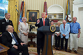 U.S. President Donald J. Trump speaks while visiting with survivors from the USS Arizona at The White House in Washington, DC, July 21, 2017. Two of the survivors seen in the photo are Lauren Bruner(in wheelchair) and Donald Stratton(2nd right.) <br /> Credit: Chris Kleponis / Pool via CNP