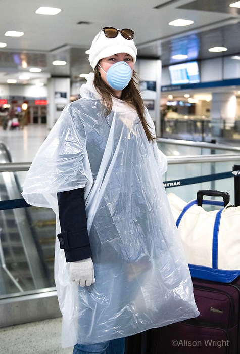 """3/26/20-New York, New York City. New Yorkers are told to stay home during the corona virus, (COVID-19) so New York has become eerily empty. My mom made me dress like this,"""" says a passenger about to embark on the Amtrak train home to Virginia at a nearly empty Penn Station. Hey, no  judgement here!"""