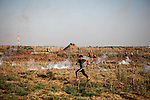 Palestinian protesters clash with Israeli troops following the tents protest where Palestinians demand the right to return to their homeland at the Israel-Gaza border, in Jabalia in the northern Gaza Strip, June 14, 2019. Photo by Ramez Haboub