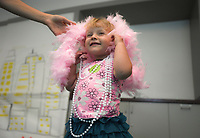 NWA Democrat-Gazette/CHARLIE KAIJO Charissa Garlow (left) puts a scarf on Tenny Garlow, 2, of Rogers (center) during a preschool costume event, Thursday, September 13, 2018 at Crystal Bridges in Bentonville.<br /><br />Kids had the opportunity to create stories with creative play and outfits.