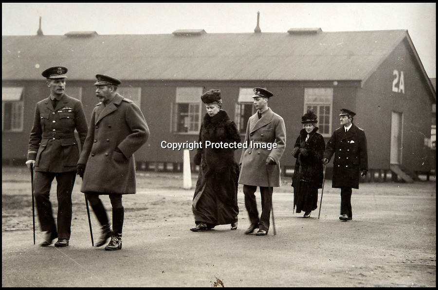 BNPS.co.uk (01202 558833)<br /> Pic: C&TAuctions/BNPS<br /> <br /> George V and Queen Mary on a visit with a young Edward Vlll.<br /> <br /> Those not so magnificent men in their flying machines...<br /> <br /> A newly discovered album of of photographs from the First War illustrates the difficulties and dangers of the earliest days of flight.<br /> <br /> Thought to have been collected by an unknown officer at the RNAS school of flying at Cranwell during the war, the album catalogues the thrills and spills of a time before health and safety.<br /> <br /> Multiple collisions, perilous carrier take off's, impacts with phone lines, random trees and even buildings are all featured - as well as a visit from the King and Queen.<br /> <br /> C&T auctions are selling the unique album on Wednesday 30th March.