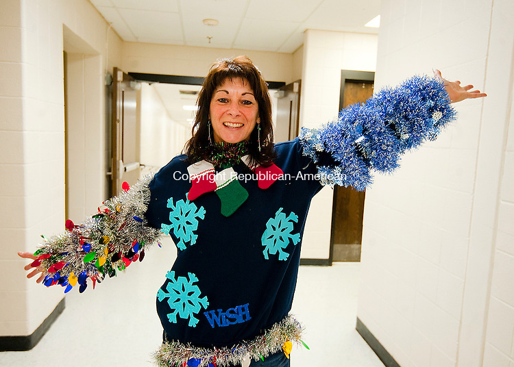 SOUTHBURY,  CT-122316JS02--Spanish teacher Ana Gagnon shows off her sweater during the annual Region 15 Best Sweater  Contest fundraiser Friday at Pomperaug High School in Southbury. Money raised from the event will go to the Victoria Soto Memorial Fund, honoring a Sandy Hook Teacher who died trying to protect children from the shooter. Jim Shannon Republican American