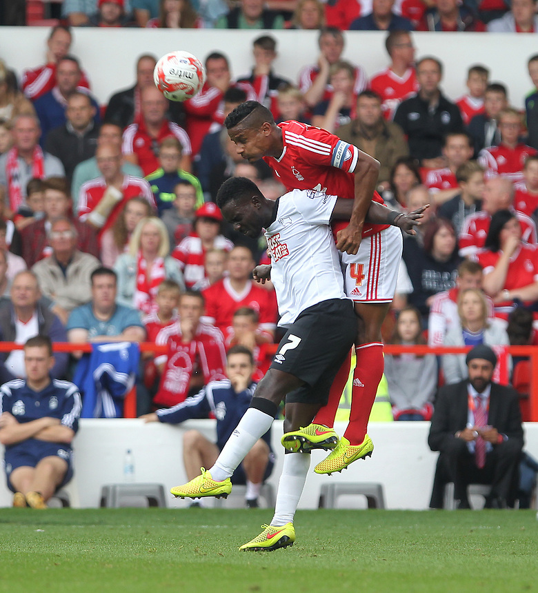 Nottingham Forest's Michael Mancienne jumps with Derby County's Simon Dawkins<br /> <br /> Photographer Mick Walker/CameraSport<br /> <br /> Football - The Football League Sky Bet Championship - Nottingham Forest v Derby County - Sunday 14th September 2014 - The City Ground - Nottingham<br /> <br /> &copy; CameraSport - 43 Linden Ave. Countesthorpe. Leicester. England. LE8 5PG - Tel: +44 (0) 116 277 4147 - admin@camerasport.com - www.camerasport.com