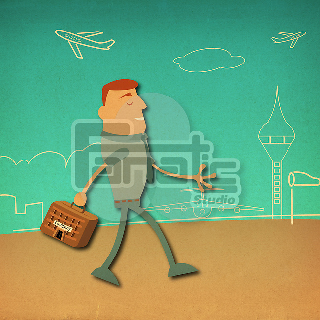 Businessman carrying a briefcase at an airport
