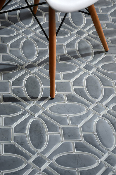 Maxwell, a stone and glass waterjet mosaic, shown in Venetian honed Bardiglio and Tropical White glass. Designed by Sara Baldwin for New Ravenna.<br />