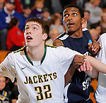 SPEARFISH, SD - FEBRUARY 2, 2013:  Riley Ryan #32 of Black Hills State works for rebounding position against Derrick January #5 of Metro State during their Rocky Mountain Athletic Conference men's basketball game Saturday evening at the Donald Young Center in Spearfish, S.D.  (Photo by Richard Carlson/dakotapress.org)