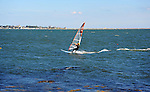 Sailboarder in choppy seas off Stonington, Connecticut USA