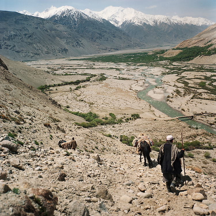 Wakhi men hike to the base of the Big Pamir Mountains as they return to their village in the Wakhan Corridor.