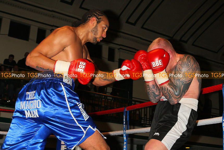 Wadi Camacho (blue shorts) defeats Rolandas Cesna in a Heavyweight boxing contest at York Hall, Bethnal Green, promoted by Left Jab - 04/03/11 - MANDATORY CREDIT: Gavin Ellis/TGSPHOTO - Self billing applies where appropriate - 0845 094 6026 - contact@tgsphoto.co.uk - NO UNPAID USE.