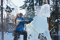 """Jeff Stahl, USA, works on the multi block sculpture titled """"Guardian Angel of Mischief"""" for the 2009 World Ice Art Championships in Fairbanks, Alaska. Team members: Heather Brice, Kevin Gregory, Jeff Stahl, Steve Cox"""