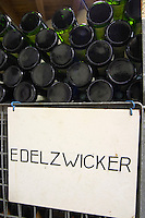 bottles stored in wire cages edelzwicker dom frederic mochel traenheim alsace france