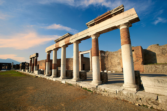 "The Roman Columns of The Building of Eumachia, Pompeii. The inscription on lintel above the columns is to Concordia Augusta, wife of Emperor Augustus, from the priestess Eumachia the patron of the ""fullones"", an artisan association of dyers. The building was a prototype of medieval hostels were travelling merchant rented accommodation."