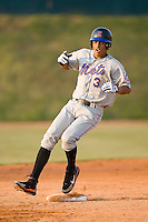Rafael Fernandez (3) of the Kingsport Mets pulls into second base with a double at Howard Johnson Field in Johnson City, TN, Thursday July 3, 2008.