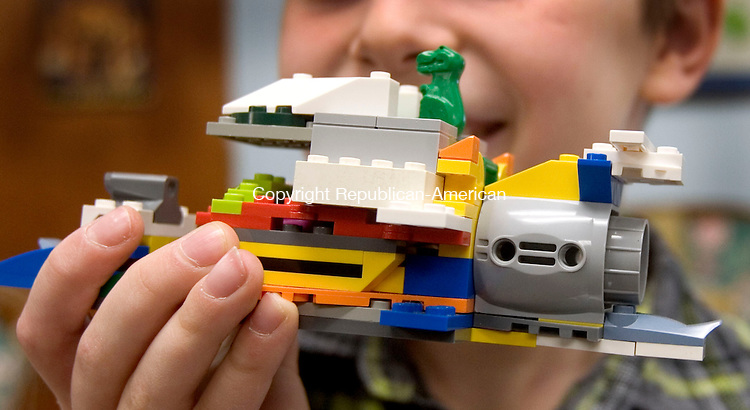 BETHLEHEM CT. 15 February 2014-021514SV06-Joe Primerano, 10, of Bethlehem shows off his spaceship creation during the Lego Club at the library in Bethlehem Saturday. The program is funded by a grant from Thomaston Savings Bank and is open to all school-aged children. <br /> Steven Valenti Republican-American
