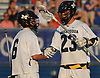 Matt Weigand #23, left, and goalie Mike Venezia #6 of Massapequa shake hands after their team's 11-3 win over Port Washington in the Nassau County varsity boys lacrosse Class A semifinals at Shuart Stadium, located on the campus Hofstra University in Hempstead, on Thursday, May 24, 2018.