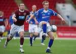 St Johnstone v Hearts...25.09.11   SPL Week 9.Alan Maybury is pulled back by Stephen Elliott.Picture by Graeme Hart..Copyright Perthshire Picture Agency.Tel: 01738 623350  Mobile: 07990 594431