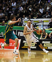 Tall blacks guard Lindsay Tait drives around Joe Ingles during the International basketball match between the NZ Tall Blacks and Australian Boomers at TSB Bank Arena, Wellington, New Zealand on 25 August 2009. Photo: Dave Lintott / lintottphoto.co.nz