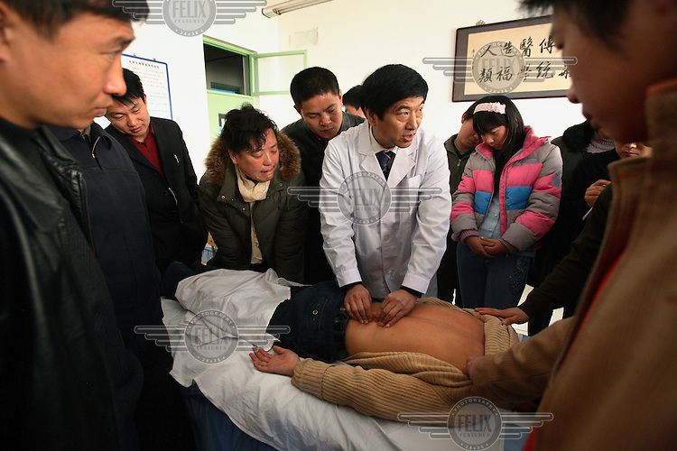 Professor Cheng gives a massage class at the Massage Vocational School in Fengtai district. The school is growing in popularity due to the upcoming Olympic Games, when thousands of massage experts will be needed...