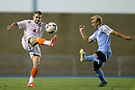 08 October 2013: Clemson's Jack Metcalf (ENG) (4) and North Carolina's Verneri Valimaa (right). The University of North Carolina Tar Heels hosted the Clemson University Tigers at Fetzer Field in Chapel Hill, NC in a 2013 NCAA Division I Men's Soccer match. Clemson won the game 2-1 in overtime.