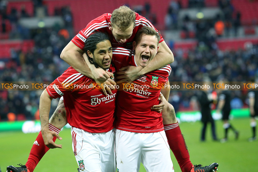 Danny Wright jumps on the back of Chris Westwood and Joe Clarke to celebrate Wrexham's Trophy win - Wrexham vs Grimsby Town - FA Challenge Trophy Final at Wembley Stadium, London - 24/03/13 - MANDATORY CREDIT: Gavin Ellis/TGSPHOTO - Self billing applies where appropriate - 0845 094 6026 - contact@tgsphoto.co.uk - NO UNPAID USE.