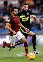 Calcio, Serie A: Roma vs Hellas Verona. Roma, stadio Olimpico, 17 gennaio 2016.<br /> Roma&rsquo;s Mohamed Salah, left, is challenged by Hellas Verona&rsquo;s Mohamed Fares during the Italian Serie A football match between Roma and Hellas Verona at Rome's Olympic stadium, 17 January 2016.<br /> UPDATE IMAGES PRESS/Isabella Bonotto