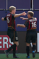 John Wolyniec of the MetroStars celebrates scoring a goal with teammate Richie Williams. The Chicago Fire defeated the NY/NJ MetroStars 2-1 on 8/24/03 at Giant's Stadium, NJ..