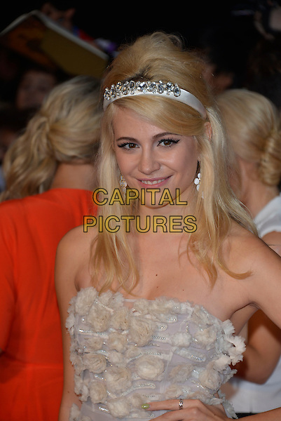 Victoria Louise &quot;Pixie&quot; Lott<br /> The Daily Mirror's Pride of Britain Awards arrivals at the Grosvenor House Hotel, London, England.<br /> 7th October 2013<br /> half length white sheer strapless dress applique eadband <br /> CAP/PL<br /> &copy;Phil Loftus/Capital Pictures
