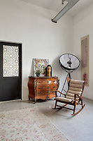 A converted shoe factory blends old world flavour with warehouse edge. A Samaan Khawam self-portrait on an antique French Louis XV commode, near a Gio Ponti rocking chair. On the wall, a Joseph Hnein painting.