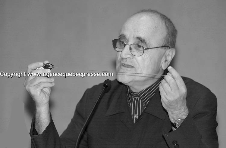 August 12,  2003, Montreal, Quebec, Canada<br /> <br /> Serge Losique, President World Film Festival<br /> explain the new Telefilm Canada'rule of  20 % content at Festivals, to  the medias during a  press conference, august 12,  2003  in Montreal, CANADA<br /> <br /> This new rule force the Festival to measure all it's movie and compute the percentage of Canadian content using a complicated formula.<br /> <br /> Mandatory Credit: Photo by Pierre Roussel- Images Distribution. (&copy;) Copyright 2003 by Pierre Roussel