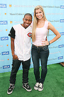 SANTA MONICA, CA - OCTOBER 21:  Carlon Jeffery and Allie Deberry at the Mattel Party On The Pier Benefiting Mattel Children's Hospital UCLA - Red Carpet at Pacific Park at Santa Monica Pier on October 21, 2012 in Santa Monica, California. © mpi20/MediaPunch Inc. /NortePhoto