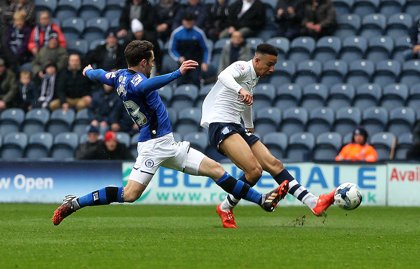 Preston North End's Callum Robinson fails to convert a good chance as Rochdale's Rhys Bennett lunges in<br /> <br /> Photographer Mick Walker/CameraSport<br /> <br /> Football - The Football League Sky Bet League One - Preston North End v Rochdale -  Friday 3rd April 2015 - Deepdale - Preston<br /> <br /> &copy; CameraSport - 43 Linden Ave. Countesthorpe. Leicester. England. LE8 5PG - Tel: +44 (0) 116 277 4147 - admin@camerasport.com - www.camerasport.com