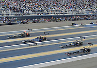 Apr. 14, 2012; Concord, NC, USA: NHRA top fuel dragster drivers (top to bottom) Tony Schumacher, Antron Brown, Brandon Bernstein and Steve Torrence race down track during qualifying for the Four Wide Nationals at zMax Dragway. Mandatory Credit: Mark J. Rebilas-