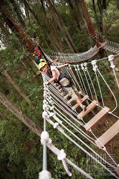 Walking across bridge Ziplining on the Big island with Kohala zipline