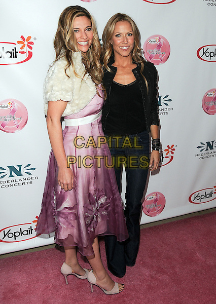 DR. FRUNK & SHERYL CROW.Sheryl Crow Breast Cancer Awareness Benefit Concert held at the Pantages Theatre, 16th November 2010..full length black jacket leather wide leg jeans flared flares top pink dress cream fur bolero cropped jacket .CAP/ADM/JS.©Jay Steine/AdMedia/AdMedia/Capital Pictures.