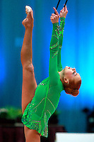 "Natalya Godunko of Ukraine balances with clubs at 2008 World Cup Kiev, ""Deriugina Cup"" in Kiev, Ukraine on March 23, 2008. .Photo note: Closeup view version."