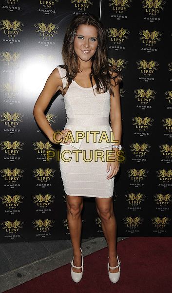Gemma Oaten<br /> The Lipsy VIP Fashion Awards 2013, DSTRKT, Rupert St., London, England.<br /> May 29th, 2013<br /> full length white sleeveless peplum dress hand on hip<br /> CAP/CAN<br /> &copy;Can Nguyen/Capital Pictures