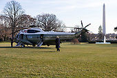 United States President Donald J. Trump walks across the South Lawn of the White House as he Boards Marine One on his way to meet with wounded service members at Walter Reed Military Hospital in Washington, D.C. on December 21st, 2017. Credit: Alex Edelman / CNP