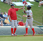 Infielder Jonathan Singleton (29) of the Lakewood BlueClaws is congratulated rounding the bases after hitting a home run in a game against the Greenville Drive on May 13, 2010, at Fluor Field at the West End in Greenville, S.C.