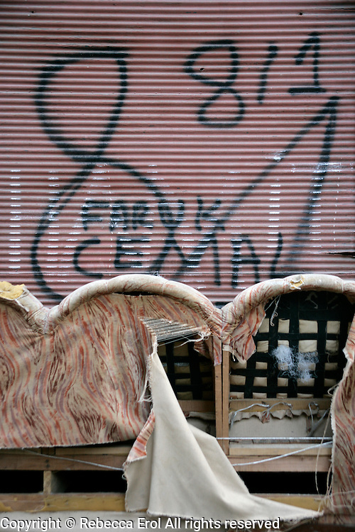 Old settee and graffitti on an old house in Beyoglu, Istanbul, Turkey