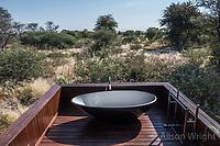Africa, Botswana, Khwai, The Lodge, Feline Fields, edge of the Kalahari desert. Outdoor bathtub.