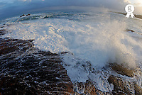 Waves breaking on rocky shore by stormy day at dusk, South Africa, South Western Cape, Hermanus,  (Licence this image exclusively with Getty: http://www.gettyimages.com/detail/81867388 )