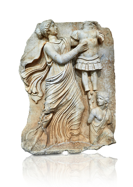 Roman Sebasteion relief  sculpture of a Goddess inscribing a trophy, Aphrodisias Museum, Aphrodisias, Turkey.   Against a white background.<br /> <br /> A draped goddess strides forward to inscribe a military trophy to which is bound a kneeling female captive. The goddess is probably a personification such as Honour, Virtue or Courage.