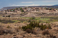 The Pueblo of Laguna, the largest of the Keresan pueblos, is 45 miles west of Albuquerque on Route 66.  Its most prominent landmark, the whitewashed St. Joseph Church, is readily visible from the road.  The entire pueblo covers four large counties and includes the six villages of Encinal, Laguna, Mesita, Paguate, Paraje, and Seama. Listed in the National Register of Historic Places since 1973, the district consists of approximately 108 acres including a southeastern section of the pueblo that dates from the 1400s and a larger section established in 1699.