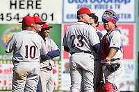 Lehigh Valley Ironpigs manager Ryne Sandberg #23 makes a pitching change during the second game of a double header against the Rochester Red Wings at Frontier Field on April 14, 2011 in Rochester, New York.  Joining Sandberg from left is Ronnie Belliard #10, Robert Hudson #2, Josh Barfield #5, Jeff Larish #11, and Dane Sardina #22.  Lehigh Valley defeated Rochester 5-3 in extra innings.  Photo By Mike Janes/Four Seam Images