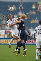 Chicago Fire forward Brian McBride (20) and New England Revolution defender Pat Phelan (28) battle for head ball. The Chicago Fire defeated the New England Revolution, 1-0, at Gillette Stadium on June 27, 2010.